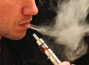 a man vaping using a vaporizer