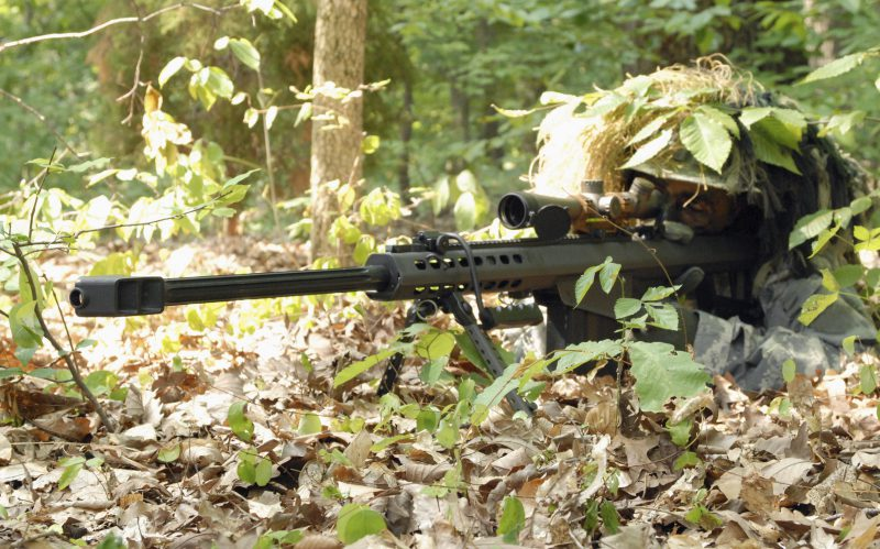 Barrett assault rifle being aimed by a hidden soldier