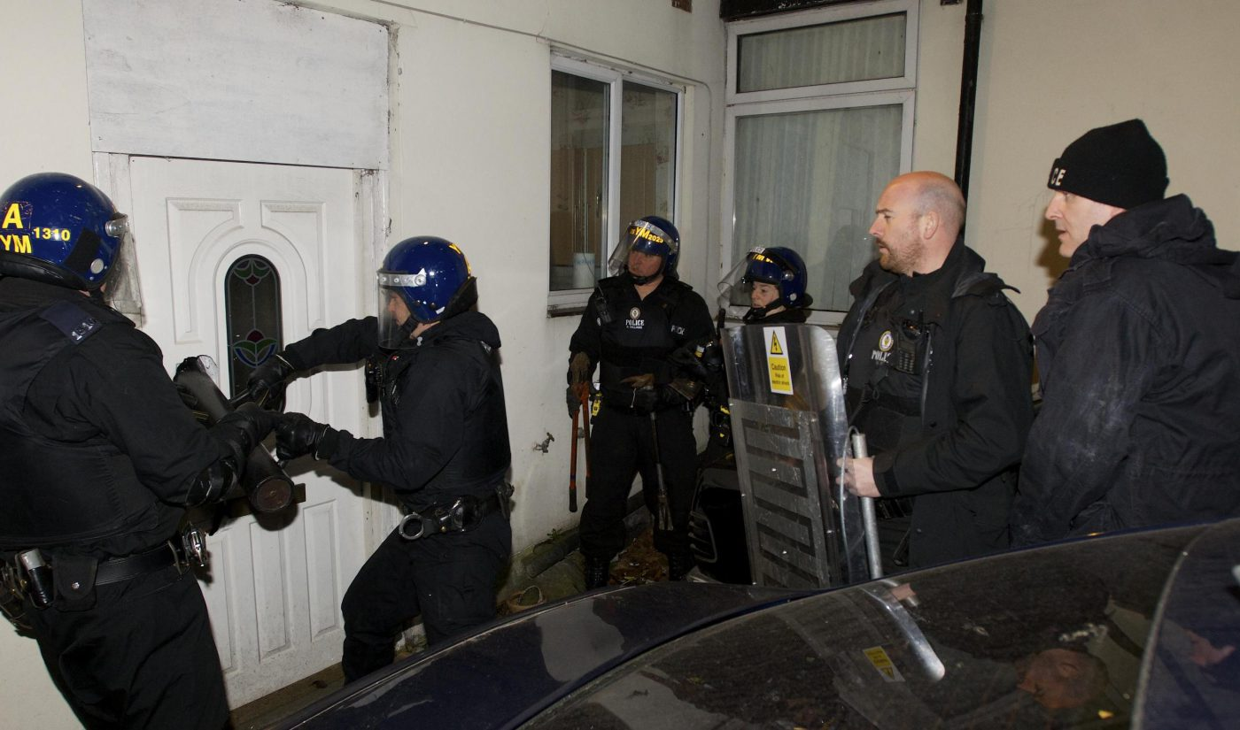 police raid a home suspected of having cannabis on site