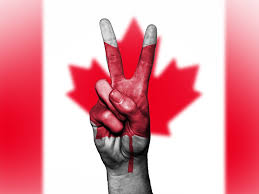 hand peace symbol superimposed over the the canadian flag